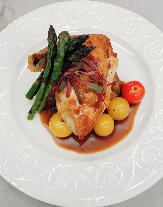 Statler Chicken Breast, Fingerling Potatoes, Asparagus, Cherry Tomato and Demi Glace.